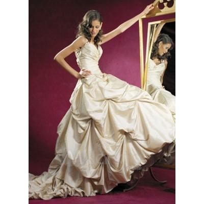 Goudkleurige jurk. Maat 38